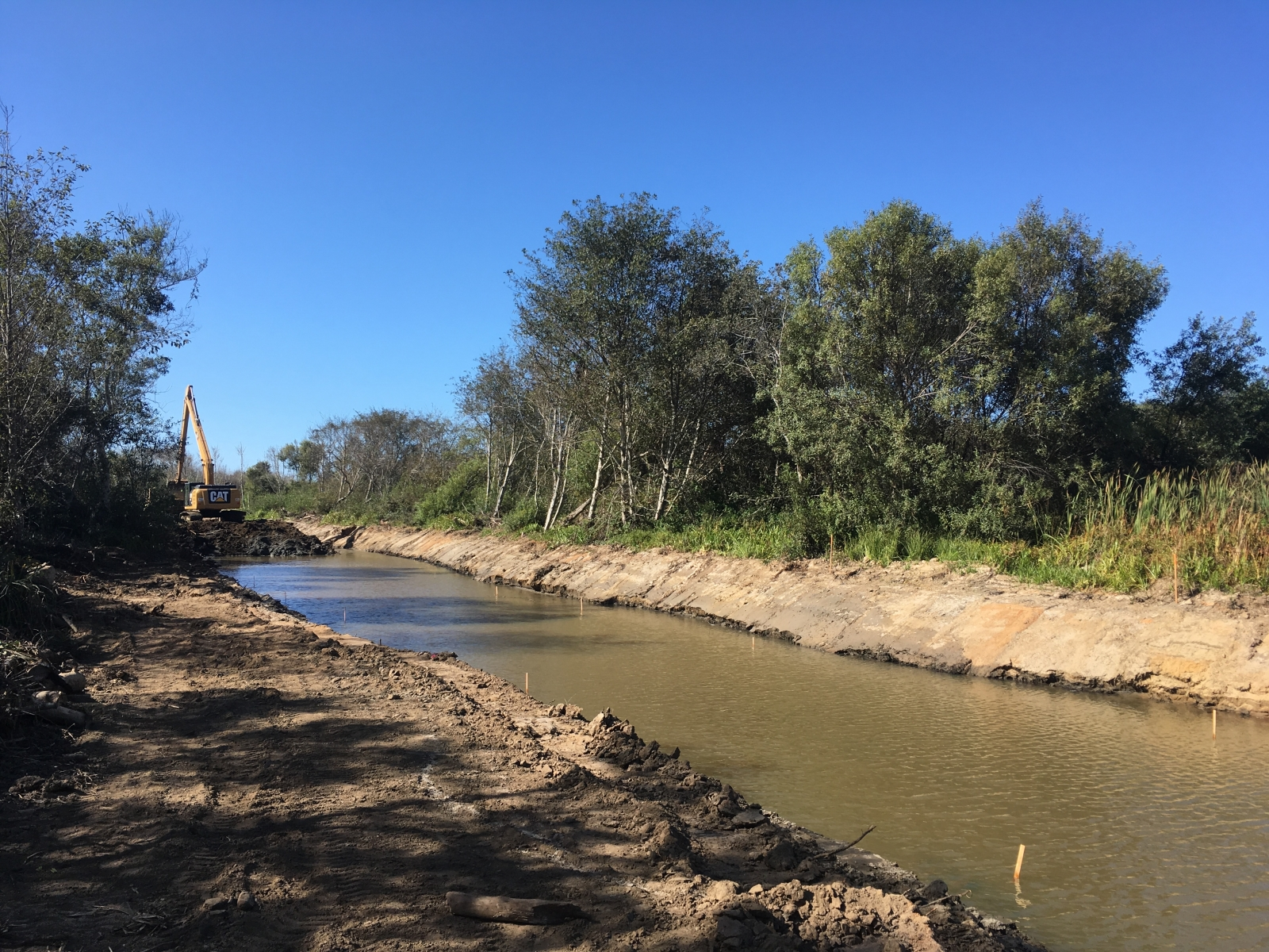 Upper Reach Excavation - Looking downstream from Pescadero Creek Rd. Bridge, the excavator completes final excavation of the Butano channel.September 2019
