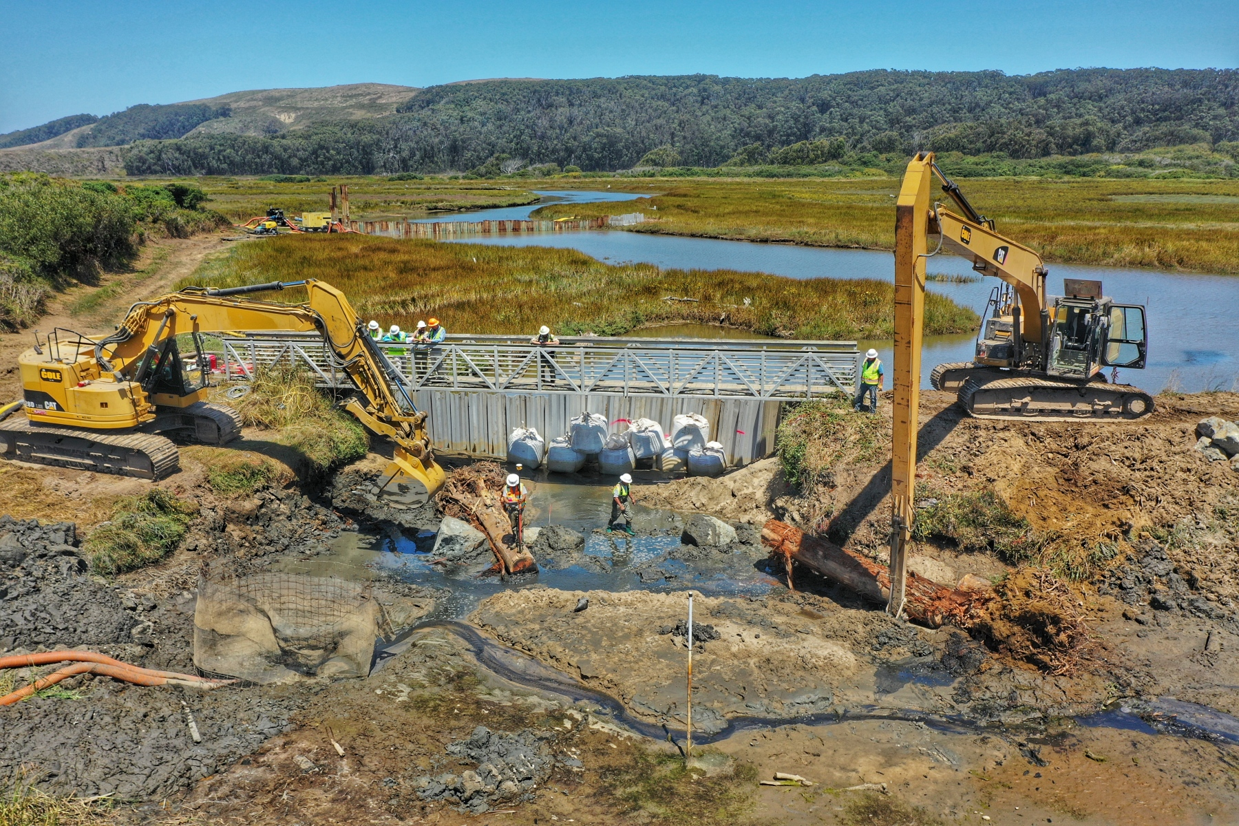 Replacing sandbag dam with organic water & sediment control structure.
