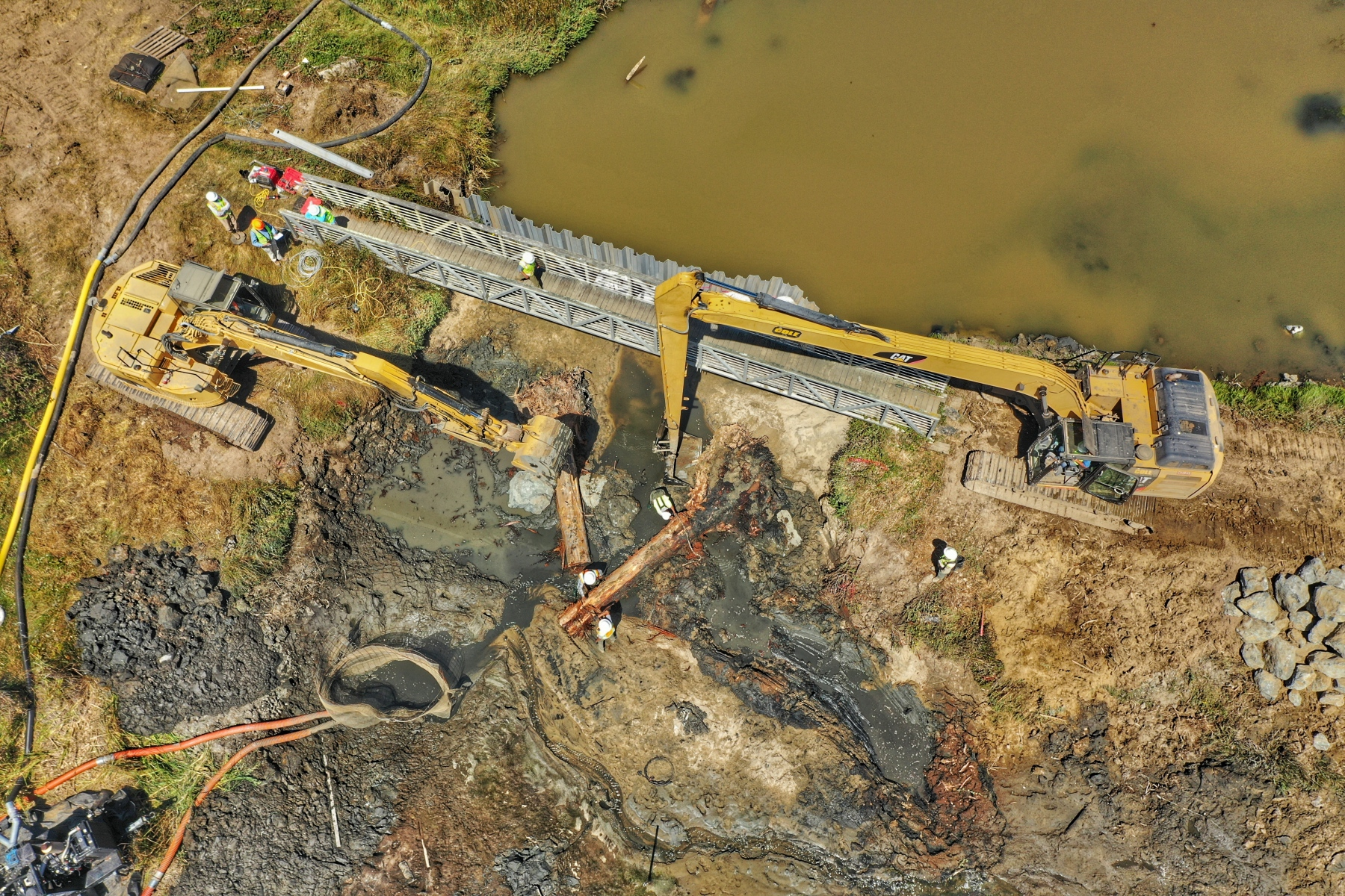 Overhead view of sandbag dam removal, August 2019
